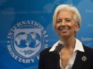 CORRECTION / IMF Managing Director Christine Lagarde smiles during a press conference at the International Monetary Fund (IMF) in Washington, DC, on February 19, 2016. Lagarde, who battled financial fires across Europe as managing director of the International Monetary Fund, was officially named to a second five-year term. / AFP / Andrew Caballero-Reynolds